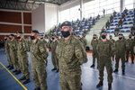 Kosovo Security Force (KSF) members wearing protective face masks line up during a peacekeeping mission deployment ceremony held at the army barracks in Pristina, Tuesday, March 9, 2021. Kosovo is sending a military platoon to Kuwait, its first ever involvement in an international peacekeeping mission. A ceremony was held Tuesday at the army barracks in the capital, Pristina, with the presence of top country leaders and western military attaches. Kosovo is sending the military unit following a request from the U.S. Central Command. (AP Photo/Visar Kryeziu)