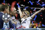 New England Patriots' Tom Brady celebrates with his daughter, Vivian, after the NFL Super Bowl 53 football game against the Los Angeles Rams, Sunday, Feb. 3, 2019, in Atlanta. The Patriots won 13-3. (AP Photo/David J. Phillip)