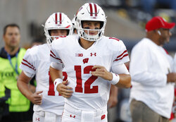 FILE - In this Sept. 22, 2018, file photo, Wisconsin quarterback Alex Hornibrook runs on the field before an NCAA college football game against Iowa, in Iowa City. Hornibrook saves his best work for last. He is 18 of 23 (78 games) for 246 yards with two scores and no interceptions this season. Wisconsin plays Nebraska on Saturday. (AP Photo/Matthew Putney, File)