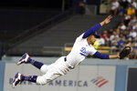 Los Angeles Dodgers second baseman Mookie Betts makes a diving catch on a line drive by Houston Astros' Michael Brantley during the fifth inning of a baseball game Tuesday, Aug. 3, 2021, in Los Angeles. (AP Photo/Marcio Jose Sanchez)