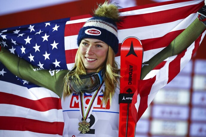 United States' Mikaela Shiffrin celebrates after winning g the bronze medal in the women's giant slalom, at the alpine ski World Championships in Are, Sweden, Thursday, Feb. 14, 2019. (AP Photo/Marco Trovati)