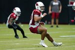 Arizona Cardinals linebacker Zaven Collins (25) and Cardinals strong safety Budda Baker (3) change directions to defend a running play during NFL football training camp practice, Saturday, July 31, 2021, in Glendale, Ariz. (AP Photo/Ross D. Franklin)