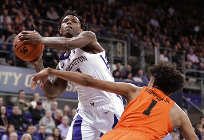 Washington forward Nahziah Carter shoots against Oregon State guard Stephen Thompson Jr. (1) during the first half of an NCAA college basketball game Wednesday, March 6, 2019, in Seattle. (AP Photo/Ted S. Warren)