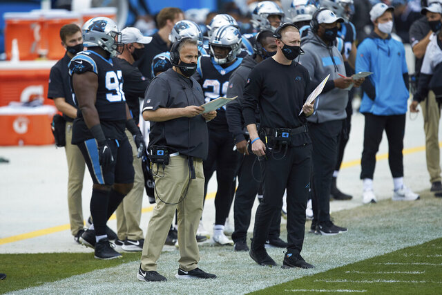 FILE - Carolina Panthers head coach Matt Rhule, left, and offensive coordinator Joe Brady watch from the sideline during an NFL football game against the Detroit Lions in Charlotte, N.C., in this, Sunday, Nov. 22, 2020, file photo. Panthers offensive coordinator Joe Brady is becoming a popular name for NFL teams seeking to fill head coaching vacancies. A person familiar with the situation says the Chargers, Falcons and Texans have all asked for and received permission from the Panthers to interview Brady for their head coaching jobs. (AP Photo/Brian Westerholt, File)