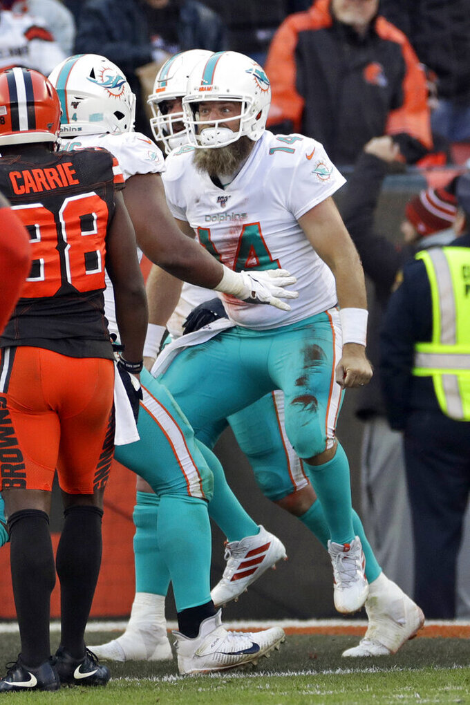 Miami Dolphins quarterback Ryan Fitzpatrick (14) celebrates an 8-yard touchdown during the second half of an NFL football game against the Cleveland Browns, Sunday, Nov. 24, 2019, in Cleveland. (AP Photo/Ron Schwane)