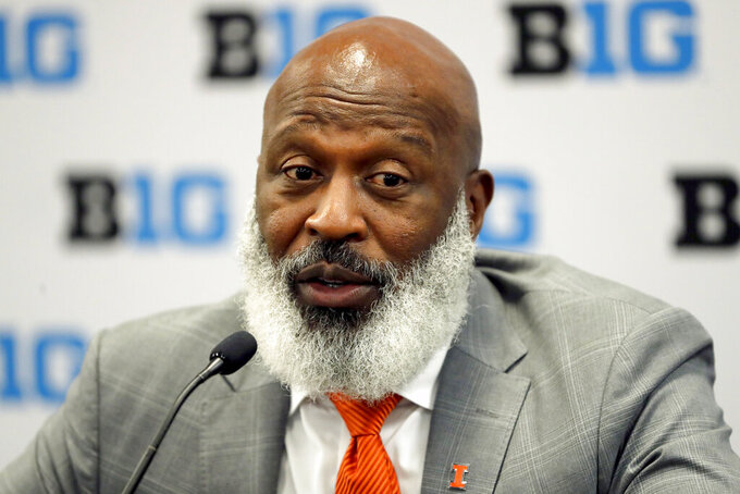 FILE - In this July 18, 2019, file photo, Illinois head coach Lovie Smith talks to reporters during the Big Ten Conference NCAA college football media days in Chicago. The Illini showed signs of turning a moribund team around last year, showing flashes of the defense former NFL coach Smith is known for. Illinois finished 4-8 last season and Smith hopes to take advantage of a soft non-conference schedule to aim for a bowl game.(AP Photo/Charles Rex Arbogast, File)