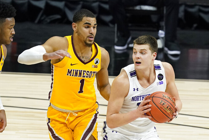 Northwestern's Miller Kopp (10) goes to the basket against Minnesota's Tre' Williams (1) during the second half of an NCAA college basketball game at the Big Ten Conference tournament, Wednesday, March 10, 2021, in Indianapolis. (AP Photo/Darron Cummings)