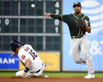 Oakland Athletics shortstop Marcus Semien, right, attempts a double play over Houston Astros' Aledmys Diaz during the second inning of a baseball game, Wednesday, Sept. 11, 2019, in Houston. Josh Reddick was safe at first. (AP Photo/Eric Christian Smith)