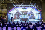 In this photo released by China's Xinhua News Agency, Tesla CEO Elon Musk speaks at a delivery ceremony for the first Tesla Model 3 cars made at Tesla's Shanghai factory in Shanghai, Tuesday, Jan. 7, 2020. Tesla's Shanghai factory delivered its first cars to customers Monday, and chief executive Elon Musk said the electric automaker plans to set up a design center in China to create a model for worldwide sales. (Ding Ting/Xinhua via AP)