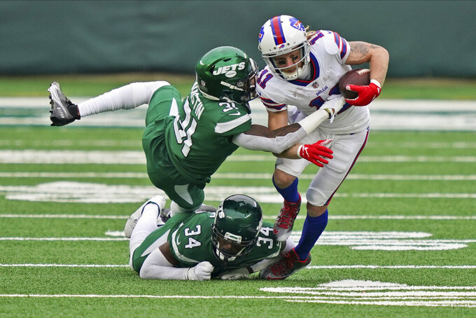New York Jets defenders try to tackle Buffalo Bills' Cole Beasley, right, during the second half of an NFL football game, Sunday, Oct. 25, 2020, in East Rutherford, N.J. (AP Photo/John Minchillo)