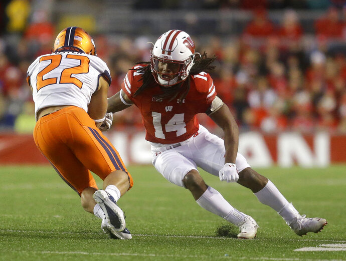File-This Nov. 12, 2016, file photo shows Wisconsin's D'Cota Dixon tackling Illinois' Kendrick Foster during an NCAA college football game in Madison, Wis. Wisconsin's typically rugged defense is getting a makeover on the edges, with new starters at cornerback, outside linebacker and defensive end. Linebackers T.J. Edwards and Ryan Connelly help form an experienced core inside.  (AP Photo/Aaron Gash, File)