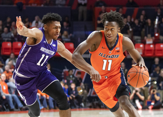 Illinois guard Ayo Dosunmu (11) drives to the basket against Northwestern guard Anthony Gaines (11) during the first half of an NCAA college basketball game in Champaign, Ill., Sunday, March 3, 2019. (AP Photo/Stephen Haas)
