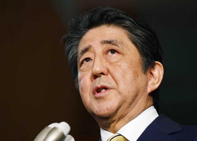 """Japan's Prime Minister Shinzo Abe speaks to reporters after the video G-7 summit at the prime minister's office in Tokyo, Tuesday, March 17, 2020.   Prime Minister Abe might be the biggest loser if the Tokyo Olympics don't go off as planned in just over four months. Abe has attached himself to the success of the Olympics since pushing hard for Tokyo's selection at an IOC meeting in 2013 in Buenos Aires, Argentina. Tokyo was picked over Istanbul by billing itself as a """"safe pair of hands.""""  (Ren Onuma/Kyodo News via AP)"""