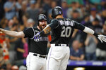 Colorado Rockies' Ian Desmond, right, celebrates his two-run home run with Daniel Murphy during the ninth inning of the team's baseball game against the San Francisco Giants on Tuesday, July 16, 2019, in Denver. (AP Photo/David Zalubowski)