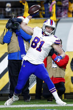 Buffalo Bills tight end Tyler Kroft (81) celebrates his touchdown on a pass from quarterback Josh Allen during the second half of an NFL football game against the Pittsburgh Steelers in Pittsburgh, Sunday, Dec. 15, 2019. (AP Photo/Keith Srakocic)