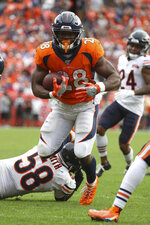 Denver Broncos running back Royce Freeman (28) carries the ball in an NFL game against the Chicago Bears, Sunday Sept. 15, 2019, in Denver. The Bears defeated the Broncos 16-14. (Margaret Bowles via AP)