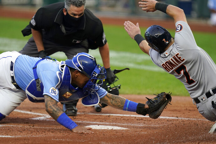 Detroit Tigers Austin Romine (7) misses the plate while sliding against Kansas City Royals catcher Salvador Perez, left, during the first inning of a baseball game at Kauffman Stadium in Kansas City, Mo., Saturday, Sept. 26, 2020. Romine was then tagged out by Perez. (AP Photo/Orlin Wagner)