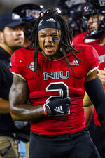 Northern Illinois linebacker Lance Deveaux Jr. (2) celebrates during the first half of an NCAA college football game against Georgia Tech, Saturday, Sept. 4, 2021, in Atlanta. (AP Photo/Danny Karnik)