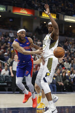 Detroit Pistons' Bruce Brown (6) makes a pass against Indiana Pacers' Myles Turner (33) during the first half of an NBA basketball game, Monday, April 1, 2019, in Indianapolis. (AP Photo/Darron Cummings)
