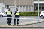 Poolice stand at the scene of a shooting incident, in the Nasby area, of Kristianstad, Sweden, Tuesday, Aug. 3, 2021. Police say that at least two people have been injured in a shooting in the southern Swedish city of Kristianstad. Swedish police received an alert on Tuesday afternoon that several loud bangs had been heard. According to preliminary information, no one was killed.  (Johan Nilsson/TT News Agency via AP)