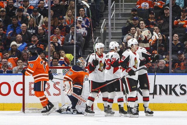 Ottawa Senators celebrate a goal against the Edmonton Oilers during the second period of an NHL hockey game Wednesday, Dec. 4, 2019, in Edmonton, Alberta. (Jason Franson/The Canadian Press via AP)