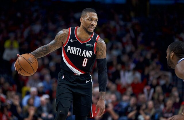 Portland Trail Blazers guard Damian Lillard brings the ball up the court against the Golden State Warriors during the second half of an NBA basketball game in Portland, Ore., Monday, Jan. 20, 2020. The Trail Blazers won 129-124 in overtime. (AP Photo/Craig Mitchelldyer)