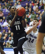 Gonzaga guard Joel Ayayi, left, shoots as Portland forward Jacob Tryon defends during the second half of an NCAA college basketball game in Portland, Ore., Thursday, Jan. 2, 2020. Gonzaga won 85-72. (AP Photo/Steve Dipaola)