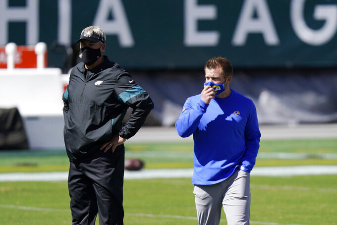 Philadelphia Eagles head coach Doug Pederson, left, and Los Angeles Rams head coach Sean McVay walks the field before an NFL football game, Sunday, Sept. 20, 2020, in Philadelphia. (AP Photo/Chris Szagola)