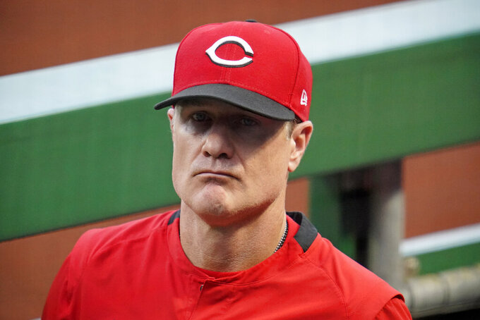 Cincinnati Reds manager David Bell stands in the dugout during a baseball game against the Pittsburgh Pirates in Pittsburgh, Tuesday, Sept. 14, 2021. (AP Photo/Gene J. Puskar)