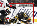 Vegas Golden Knights goaltender Marc-Andre Fleury (29) defends against the Ottawa Senators after losing one of his gloves during the second period of an NHL hockey game Thursday, Oct. 17, 2019, in Las Vegas. (AP Photo/David Becker)