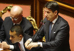 Italy's Prime Minister Giuseppe Conte intervenes in the debate at the Senate ahead of a second confidence vote on his coalition government, in Rome, Tuesday, Sept. 10, 2019. Conte on Monday won the first of two mandatory confidence votes on his four-day-old coalition of rival parties, after a day of fielding insults during a boisterous Parliament session from an opposition outraged that Italy got a new government instead of a new election. (AP Photo/Gregorio Borgia)