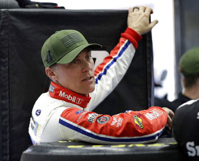 FILE - In this May 24, 2018 file photo Kevin Harvick waits for his car to go through inspection before qualifying for the NASCAR Cup series auto race at Charlotte Motor Speedway in Charlotte, N.C. NASCAR will strip victories in 2019 for illegal race cars in an effort to squash cheating and efforts to exploit the rule book. Inspections will now be done at tracks immediately following each race. If the winning car has any major infraction it will immediately be disqualified and dropped to last in the field. (AP Photo/Chuck Burton, file)