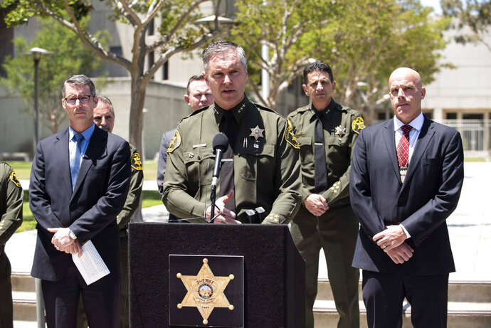 Orange County Undersheriff Don Barnes speaks to the media on Wednesday, May 16, 2018, at Orange County Sheriff's headquarters in Santa Ana, Calif., regarding a fatal explosion at an Aliso Viejo medical building the previous day. (Paul Bersebach/The Orange County Register via AP)