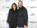 FILE - This Oct. 13, 2014 file photo shows Mariska Hargitay, left, and Dick Wolf, at the PaleyFest New York