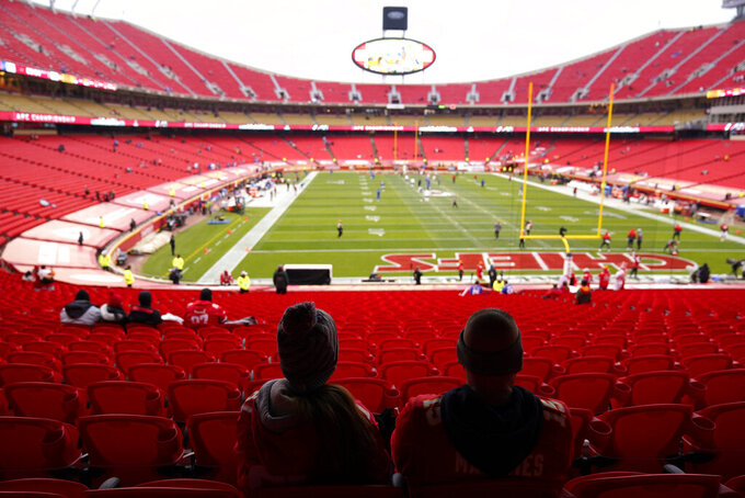 Fans watch players warm up in Arrowhead Stadium before the AFC championship NFL football game between the Kansas City Chiefs and the Buffalo Bills, Sunday, Jan. 24, 2021, in Kansas City, Mo. (AP Photo/Jeff Roberson)