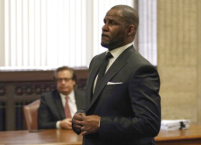 R. Kelly appears for a hearing at the Leighton Criminal Court Building on Friday, March 22, 2019 in Chicago. An overseas trip by R. Kelly is in limbo after his criminal attorney asked for more time to provide details to the court about concerts the singer wants to perform next month in Dubai.   (E. Jason Wambsgans/Chicago Tribune via AP, Pool)