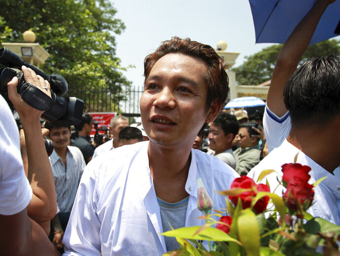 A prisoner walks outside the gate of Insein prison as he was released, Tuesday, April. 17, 2018, Yangon, Myanmar. Myanmar President Win Myint has granted amnesty to more than 8,500 prisoners, reportedly including at least three dozen political prisoners. (AP Photo/Thein Zaw)