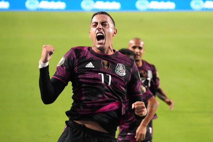Mexico forward Rogelio Funes Mori (11) celebrates after scoring a goal against Honduras during the first half of a CONCACAF Gold Cup soccer match Saturday, July 24, 2021, in Glendale, Ariz. (AP Photo/Rick Scuteri)