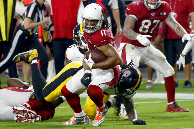 Arizona Cardinals wide receiver Larry Fitzgerald (11) is hit by Pittsburgh Steelers outside linebacker Bud Dupree during the first half of an NFL football game, Sunday, Dec. 8, 2019, in Glendale, Ariz. (AP Photo/Ross D. Franklin)
