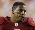 FILE - This Sept. 12, 2010, file photo shows Washington Redskins running back Clinton Portis before the start of an NFL football game against the Dallas Cowboys, in Landover, Md. Ten former NFL players have been charged with defrauding the league's healthcare benefit program. They include five who played on the Washington Redskins, including Clinton Portis and Carlos Rogers.  (AP Photo/Rob Carr, File)