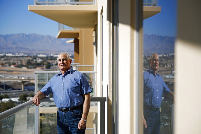 Seth Morrison, a site leader who will oversee multiple precincts at a caucus site in the metro Las Vegas area, poses for a portrait at his home in Las Vegas, Wednesday, Feb. 12, 2020. Concerns are growing that next week's Nevada caucuses could offer a repeat of the chaos that ensnared the Iowa vote. (AP Photo/Patrick Semansky)
