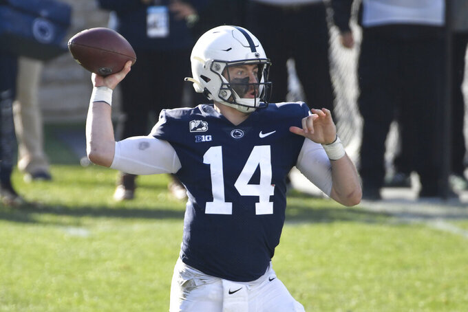 Penn State quarterback Sean Clifford (14) throws a pass against Michigan State during the second quarter of an NCAA college football game in State College, Pa., on Saturday, Dec. 12, 2020. (AP Photo/Barry Reeger)
