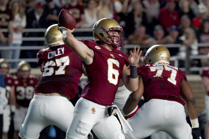 Boston College quarterback Dennis Grosel (6) looks to pass during the first half of an NCAA college football game against the North Carolina State, Saturday, Oct. 16, 2021, in Boston. (AP Photo/Mary Schwalm)