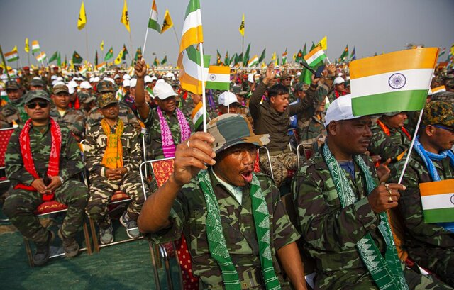National Democratic Front of Bodoland cadres shout slogans at an event to celebrate signing of a peace accord in Kokrajhar, a town 250 kilometers (150 miles) west of Gauhati, India, Friday, Feb. 7, 2020. Modi said on Friday that his government will continue its peace push in insurgency-wracked northeast bordering China and Myanmar where signing of accords with key rebel groups led to surrender by thousands of fighters. The prime minister said decades of violent insurrection ended in the Bodo tribal heartland in Assam state following the signing of the Jan. 27 agreement by the government with the rebel group. (AP Photo/Anupam Nath)