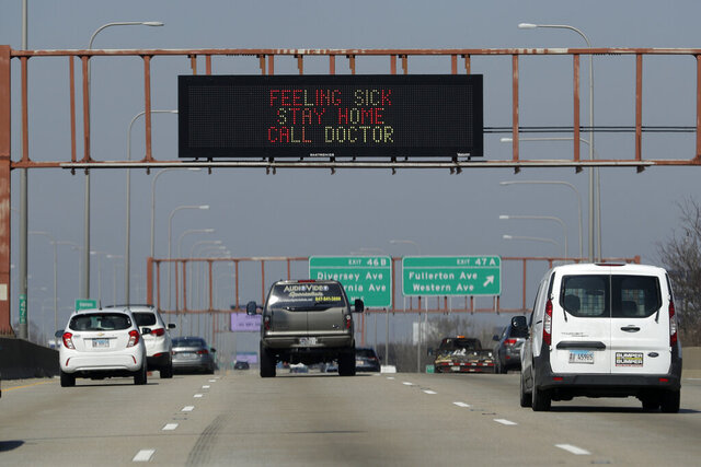 A traffic message board displays a message about coronavirus prevention along northbound Interstate 94 in Chicago, Wednesday, March 25, 2020. The new coronavirus cause mild or moderate symptoms for most people, but for some, especially older adults and people with existing health problems, it can cause more severe illness or death. (AP Photo/Nam Y. Huh)