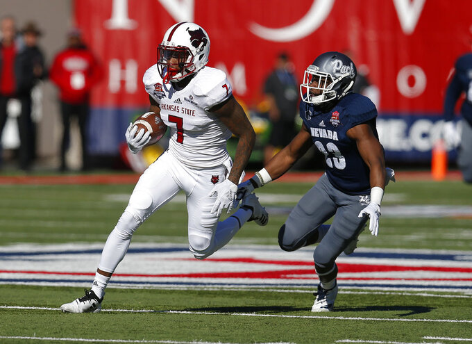 Arkansas State wide receiver Omar Bayless (7) runs away from Nevada defensive back Jomon Dotson in the first half of the Arizona Bowl NCAA college football game Saturday, Dec. 29, 2018, in Tucson, Ariz. (AP Photo/Rick Scuteri)