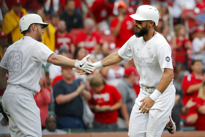 St. Louis Cardinals' Matt Carpenter, right, is congratulated by teammate Harrison Bader after hitting a solo home run during the third inning of a baseball game against the Colorado Rockies Sunday, Aug. 25, 2019, in St. Louis. (AP Photo/Jeff Roberson)