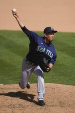 Seattle Mariners' Yoshihisa Hirano, from Japan, pitches against the Oakland Athletics during the seventh inning of a baseball game in Oakland, Calif., Sunday, Sept. 27, 2020. (AP Photo/Jeff Chiu)