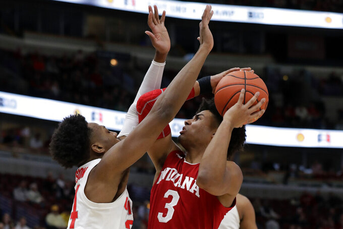 Indiana's Justin Smith (3) shoots over Ohio State's Andre Wesson (24) during the first half of an NCAA college basketball game in the second round of the Big Ten Conference tournament, Thursday, March 14, 2019, in Chicago. (AP Photo/Nam Y. Huh)