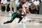 Boston Celtics' Marcus Smart, left, and Miami Heat's Duncan Robinson (55) compete for control of the ball during the second half of an NBA conference final playoff basketball game, Tuesday, Sept. 15, 2020, in Lake Buena Vista, Fla. (AP Photo/Mark J. Terrill)